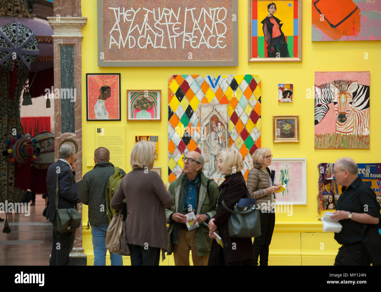 Burlington House, London, UK. 5 June, 2018. The Royal Academy's annual Summer Exhibitioncelebrates its 250th anniversary. To mark this momentous occasion, the exhibition is co-ordinated by Grayson Perry RA, who, with his committee of fellow artists have handpicked over 1,300 artworks in an array of mediums. There's a monumental sculpture by Anish Kapoor RA in the courtyard,and within the galleries you'll find vast new works by David Hockney RA and Joana Vasconcelos. Credit: Malcolm Park editorial/Alamy Live News - Stock Image
