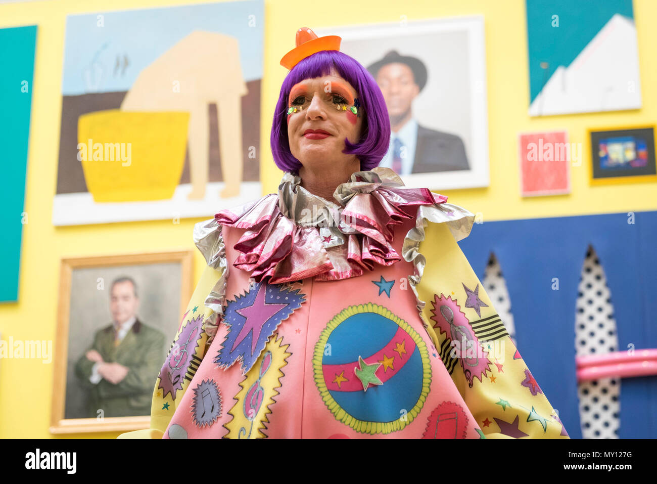 London, UK.  5 June 2018. Grayson Perry RA in one of the vividly coloured galleries at the preview of the 250th Summer Exhibition at the Royal Academy of Arts in Piccadilly, which has been co-ordinated by Grayson Perry RA this year.  Running concurrently, is The Great Spectacle, featuring highlights from the past 250 years.  Both shows run 12 June to 19 August 2018.  Credit: Stephen Chung / Alamy Live News - Stock Image