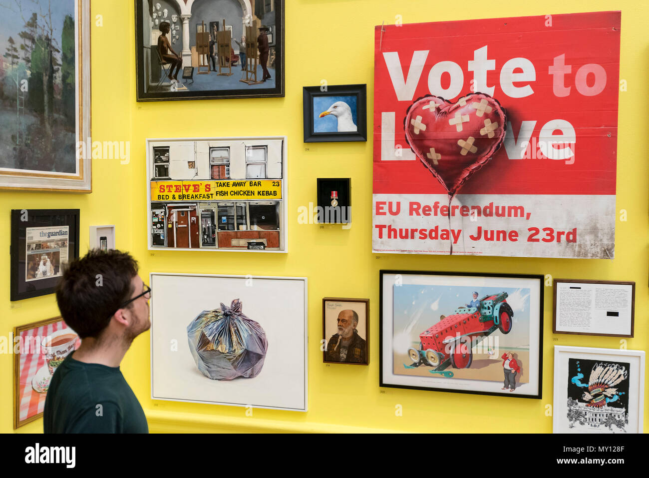 London, UK.  5 June 2018. A staff member views 'Vote to Love' by Bansky at the preview of the 250th Summer Exhibition at the Royal Academy of Arts in Piccadilly, which has been co-ordinated by Grayson Perry RA this year.  Running concurrently, is The Great Spectacle, featuring highlights from the past 250 years.  Both shows run 12 June to 19 August 2018. Credit: Stephen Chung / Alamy Live News - Stock Image