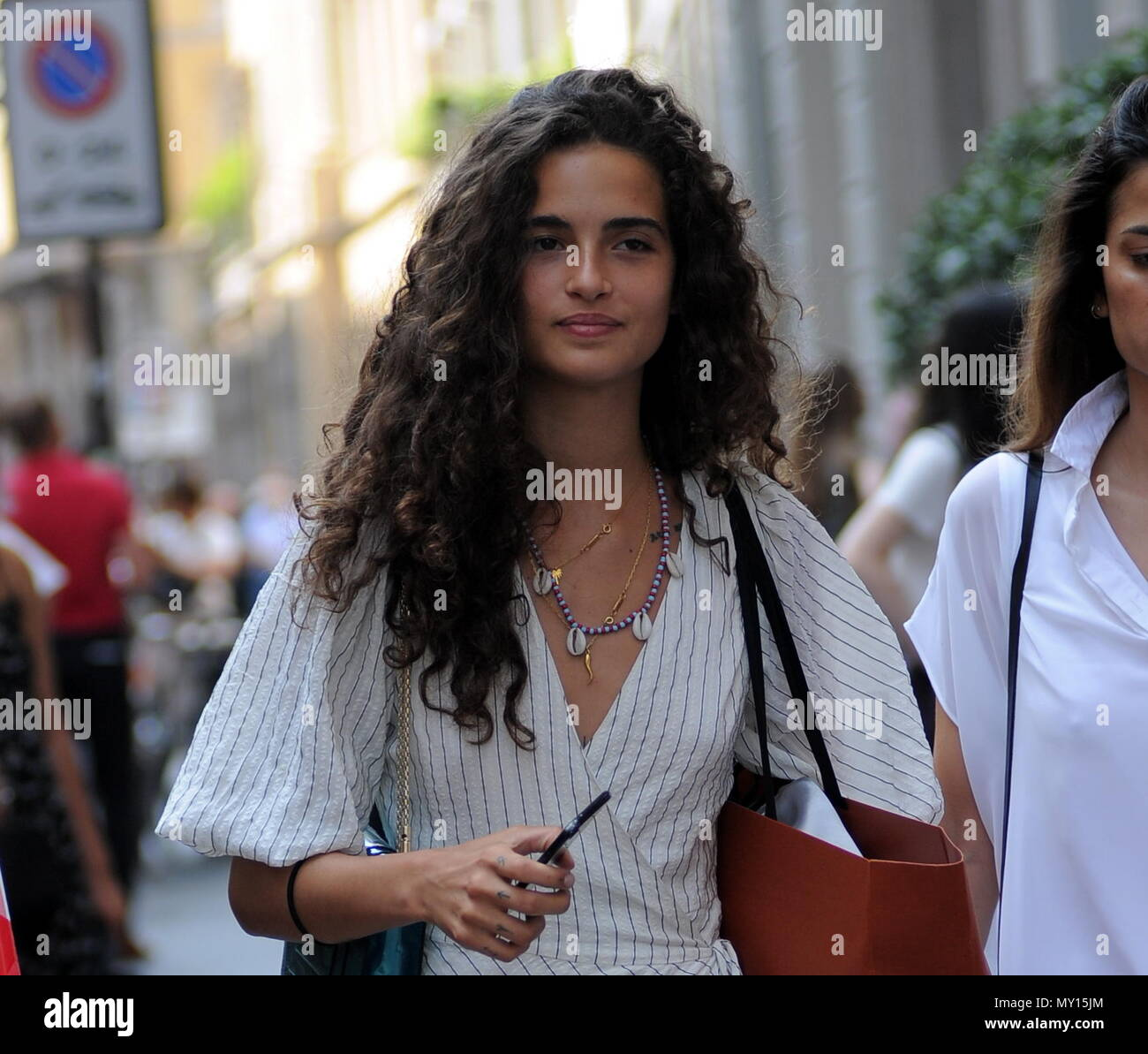 Milan, Chiara Scelsi walks in the center Chiara Scelsi, favorite model by Dolce & Gabbana stylists, walks through the streets of the center with a friend. After shopping in some boutiques, he visits Zanotti's showroom, then takes a stroll down Via Montenapoleone before leaving home. - Stock Image