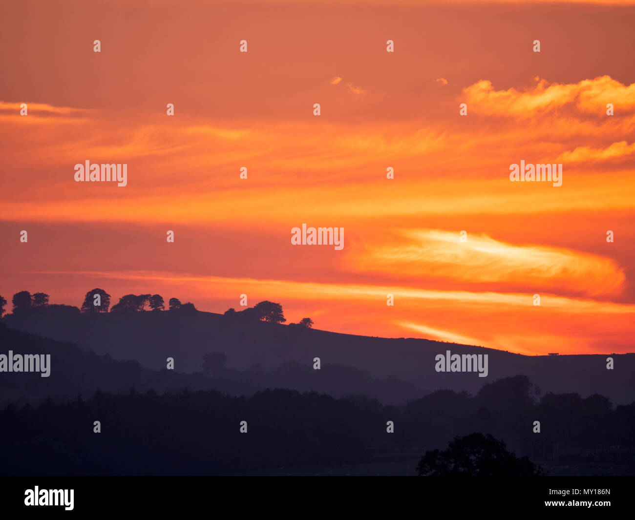 Ashbourne, Derbyshire. 5th Jun, 2018. UK Weather: spectacular sunset over the ancient woods Hazleton Clump Cairn near Thorpe taken from Ashbourne Derbyshire, Peak District National Park Credit: Doug Blane/Alamy Live NewsStock Photo