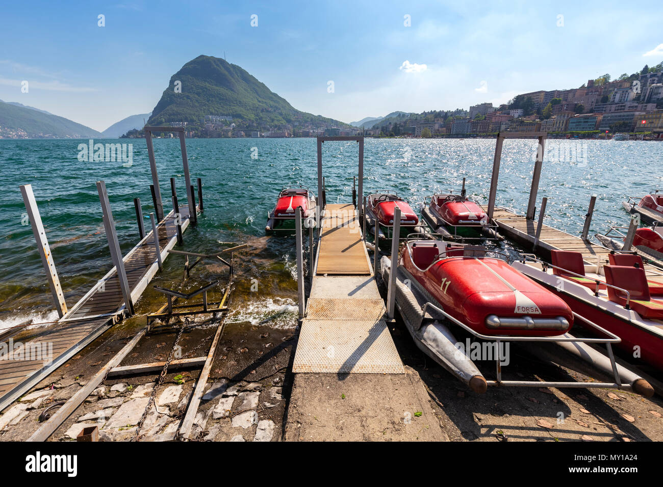 View of Lugano lakefront with the typical pedalos on a spring day, Canton Ticino, Switzerland. Stock Photo