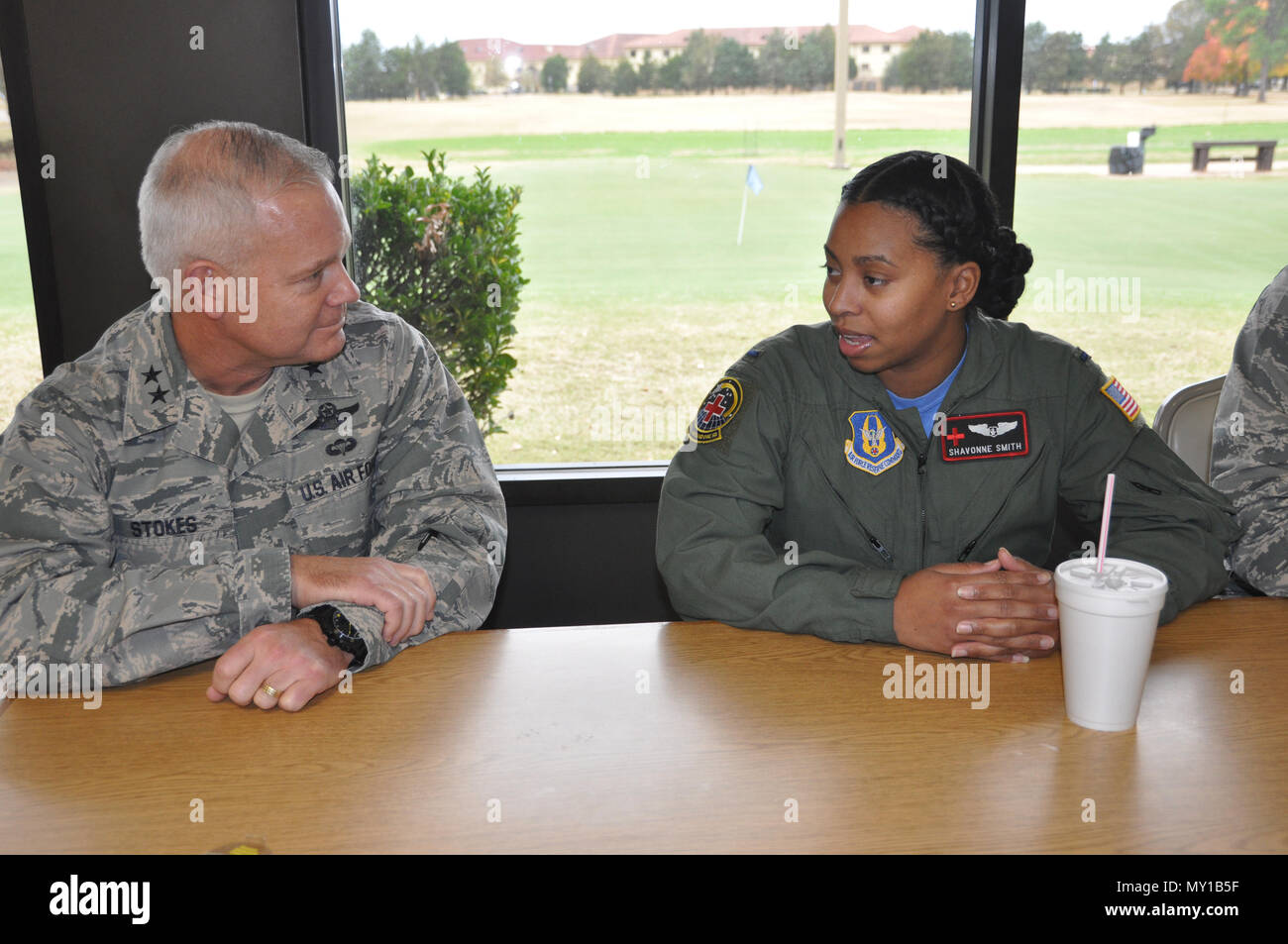 Commanding General of the 22nd Air Force, Maj. Gen. John Stokes, speaks with 1st Lt. Shavonne Smith, member of the Company Grade Officers Club while joing the club for a mentoring lunch Dec. 3 at Maxwell Air Force Base. Stokes came back to Maxwell to spend time with his old unit, the 908th Airlift Wing during the December Unit Training Assembly. (U.S. Air Force photo by Bradley J. Clark) - Stock Image