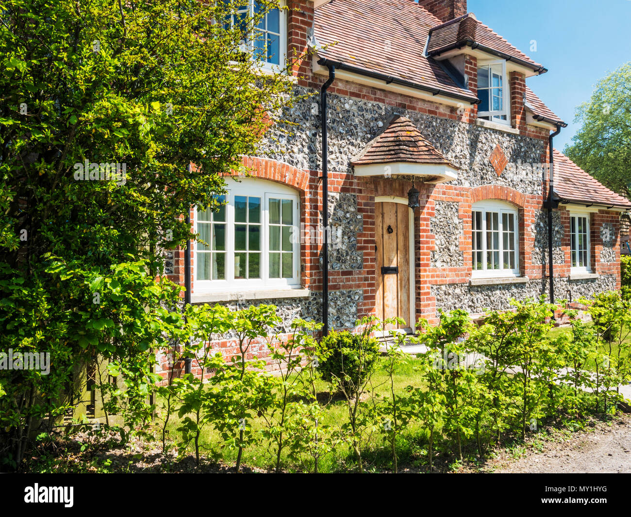 A typical brick and flint country cottage in Wiltshire. - Stock Image