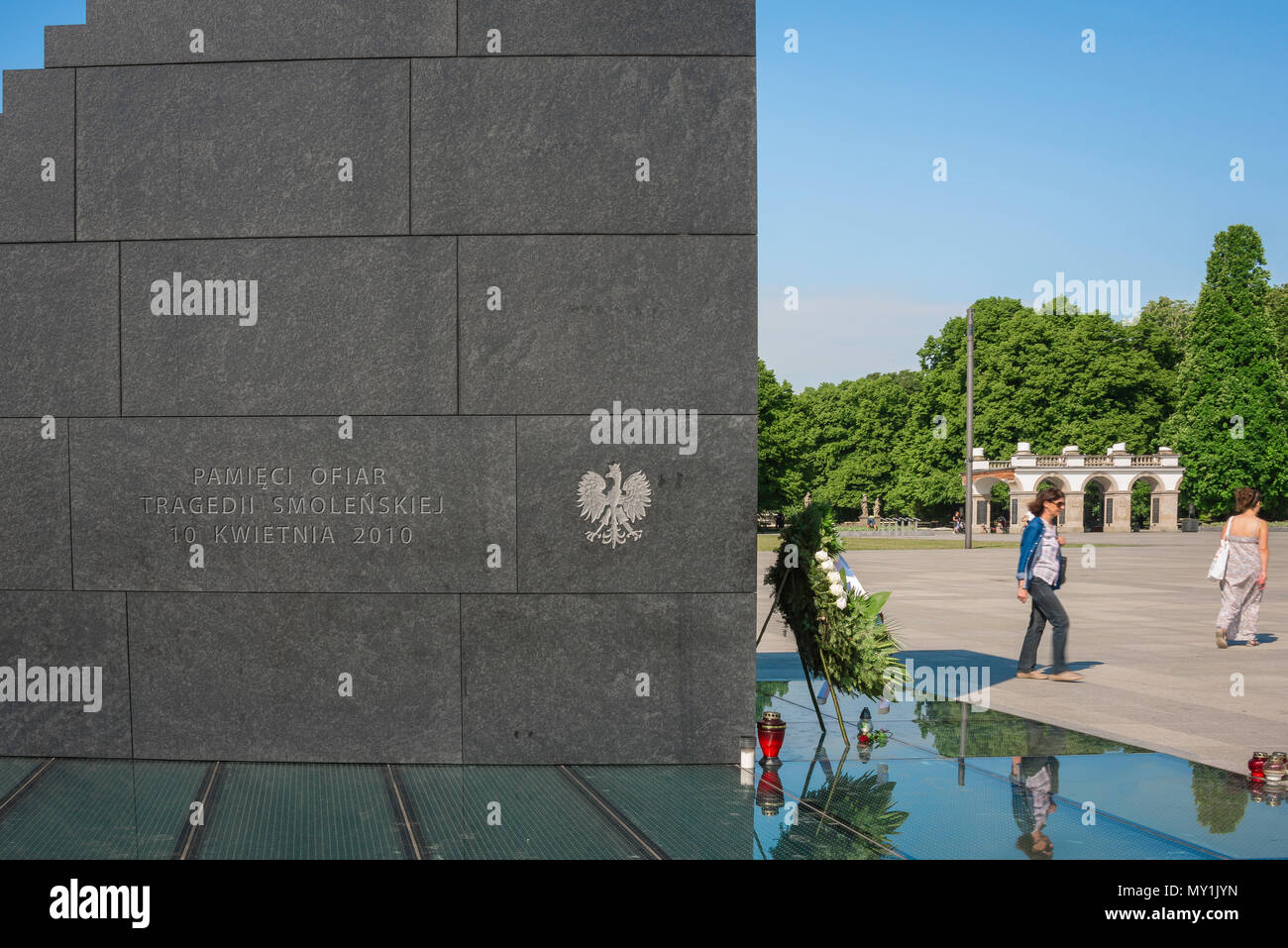 View of the side of The Monument To The Victims Of The Smolensk Air Crash with Pilsudski Square in the background, Warsaw, Poland. - Stock Image