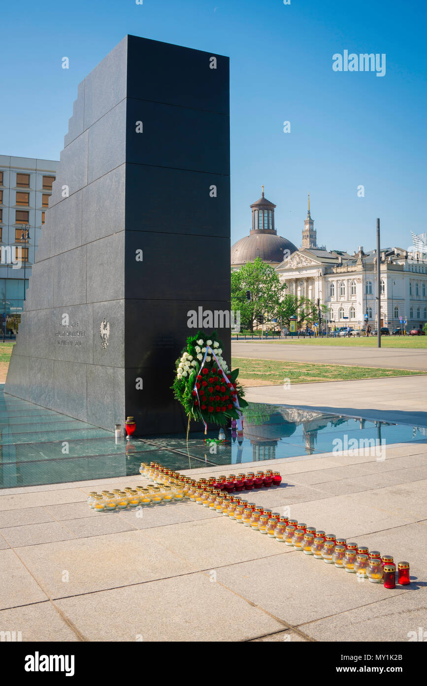 View of the Monument To The Victims Of The Smolensk Air Crash with the National Art Gallery and Lutheran Church in the background, Warsaw, Poland. - Stock Image