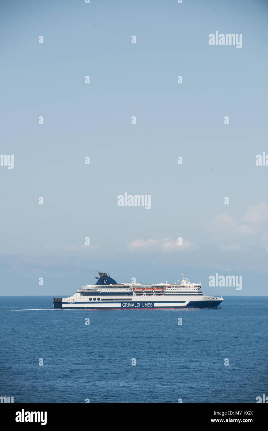 Grimaldi Lines Olbia Express navigating close to the sardinian coast. - Stock Image