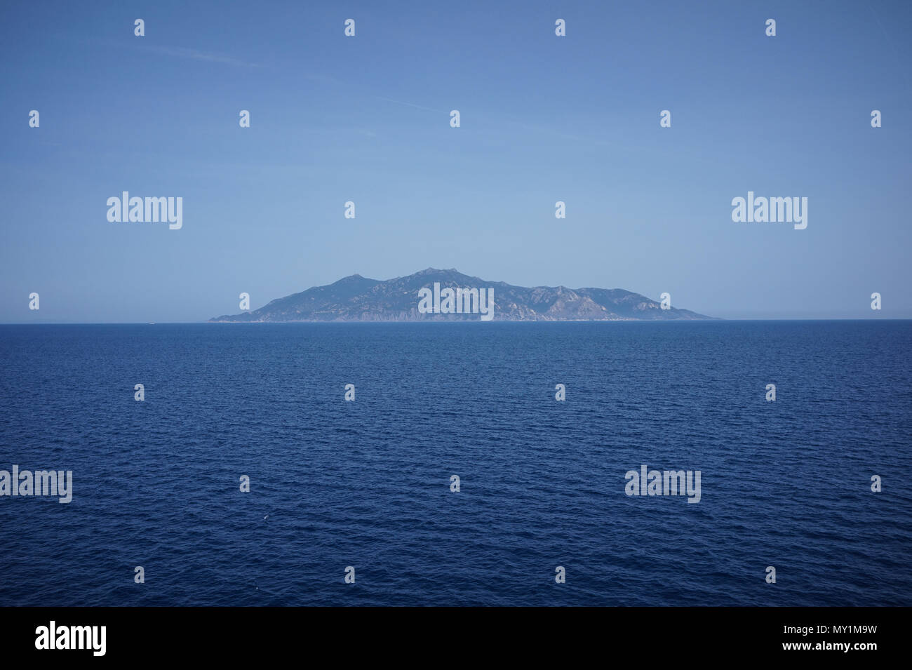 Capraia island seen from the sea - Stock Image