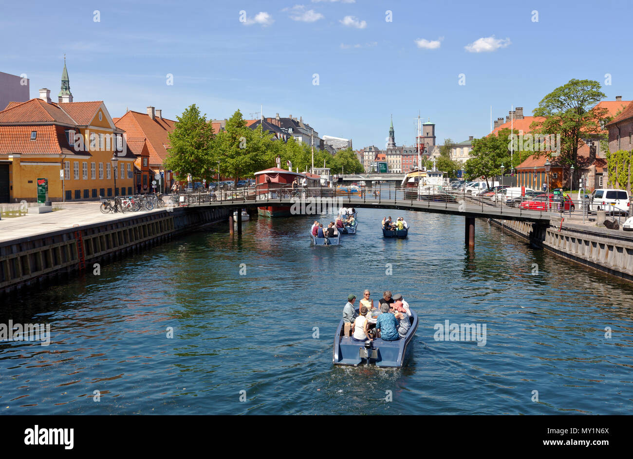 Electric Goboat picnic tour boats in Frederiksholm Canal in Copenhagen, Denmark. Pedestrian bridge and further away the Prince's Bridge, Prinsens Bro. Stock Photo