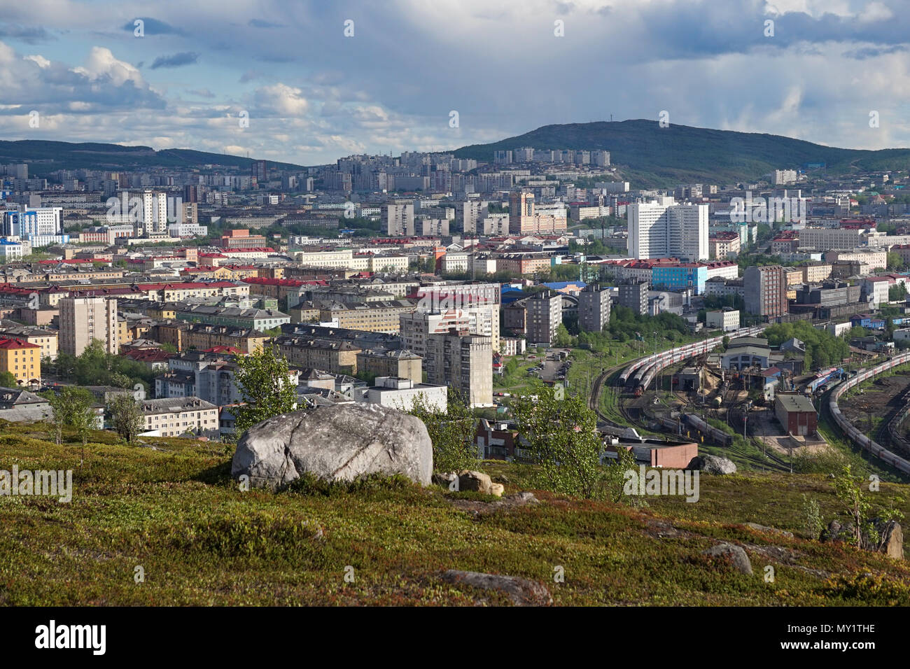 Murmansk, Russia-June 5, 2015: The urban landscape of the Murmansk Soviet architecture and the bright foliage of summer. - Stock Image