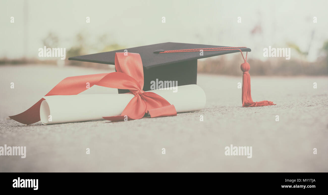 graduate hat and certificated on ground floor.color tone - Stock Image