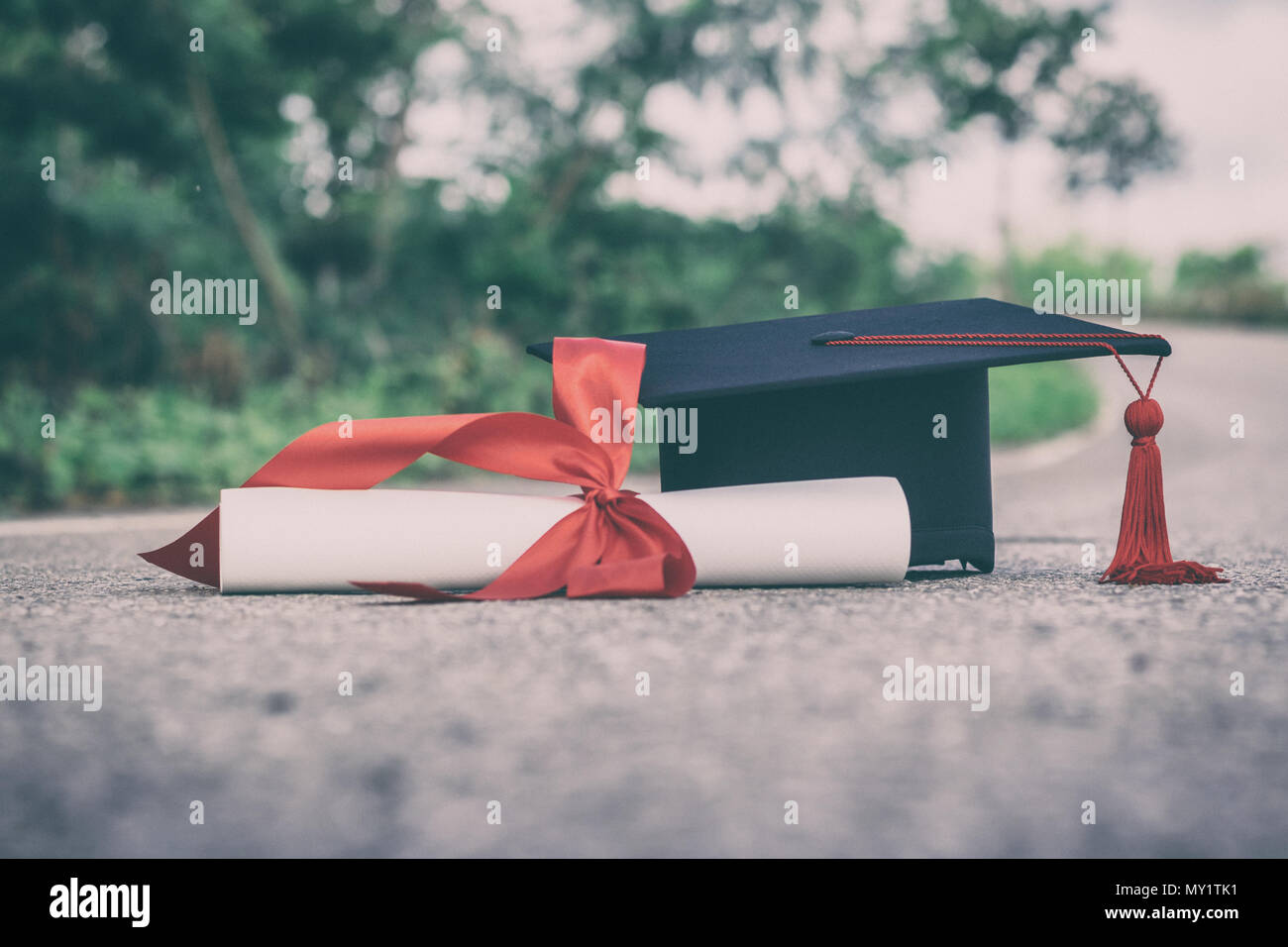graduate hat and certificated on ground floor - Stock Image