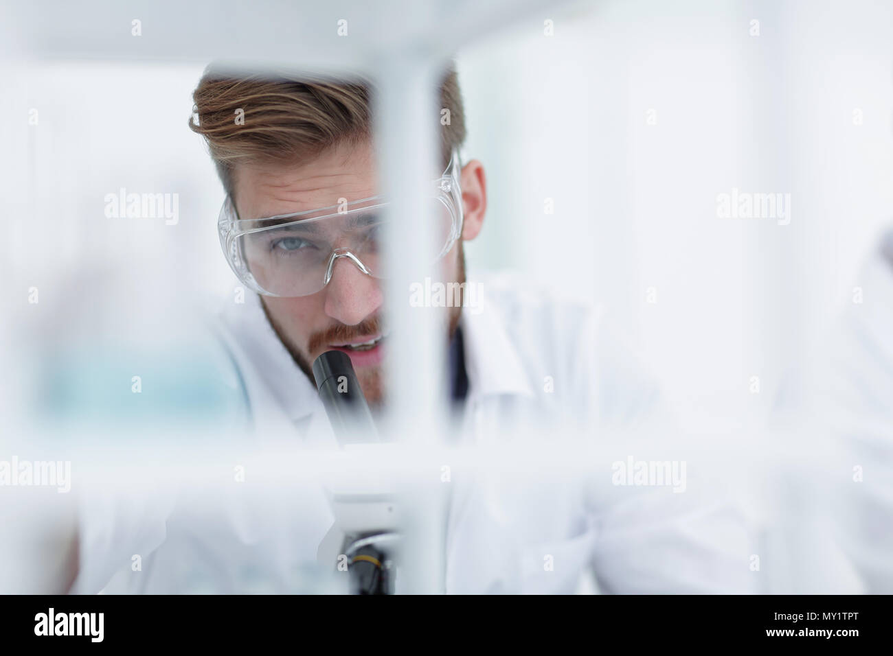 closeup. male biologist on blurred background - Stock Image
