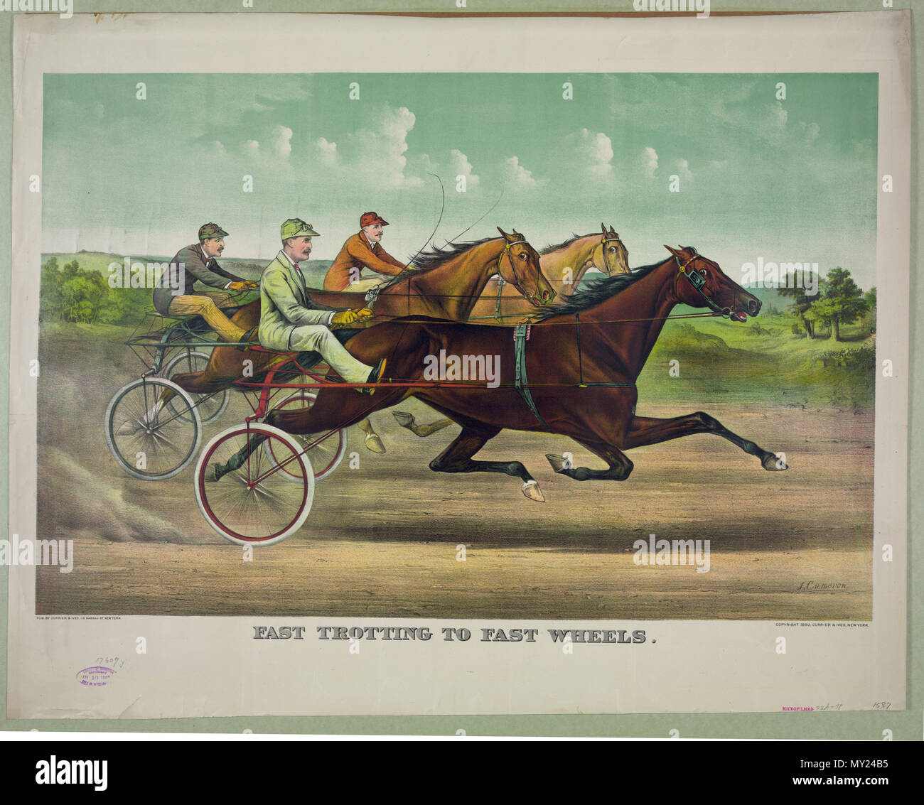 Fast trotting to fast wheels c 1893 - John Cameron - Stock Image