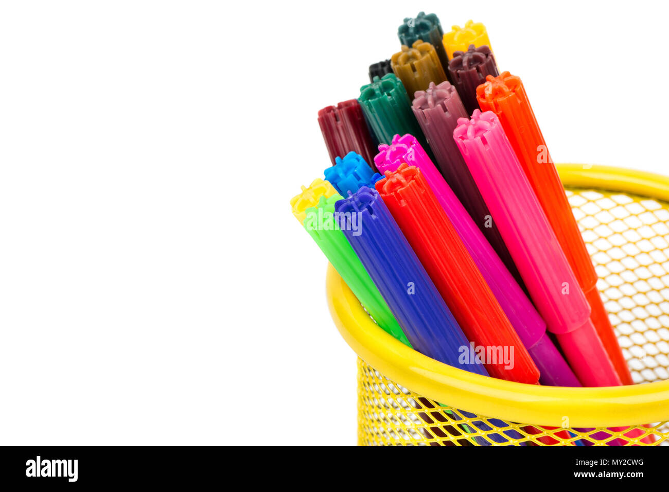 Several multi-colored markers in the pencil case close up on a blank white background - Stock Image