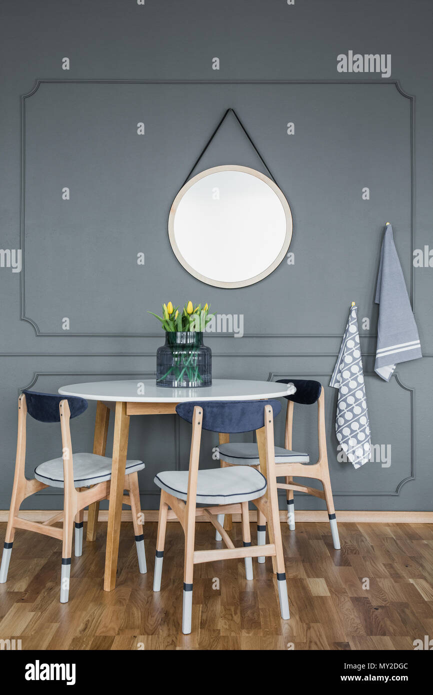 Mockup Of Round Mirror On Grey Wall Above Wooden Table And Chairs In Dining Room Interior Stock Photo Alamy