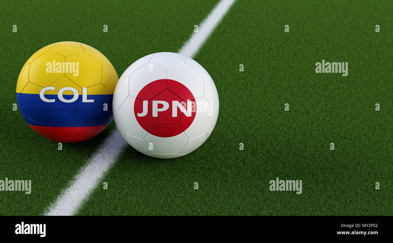Japan vs. Colombia Soccer Match - Soccer balls in Japans and Colombias national colors on a soccer field. Copy space on the right side - Stock Image