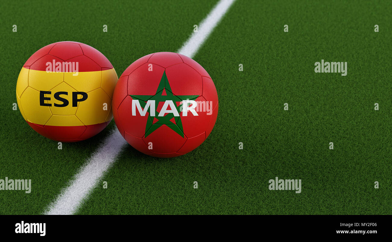 Spain vs. Morocco Soccer Match - Soccer balls in Spains and Moroccos national colors on a soccer field. Copy space on the right side - Stock Image