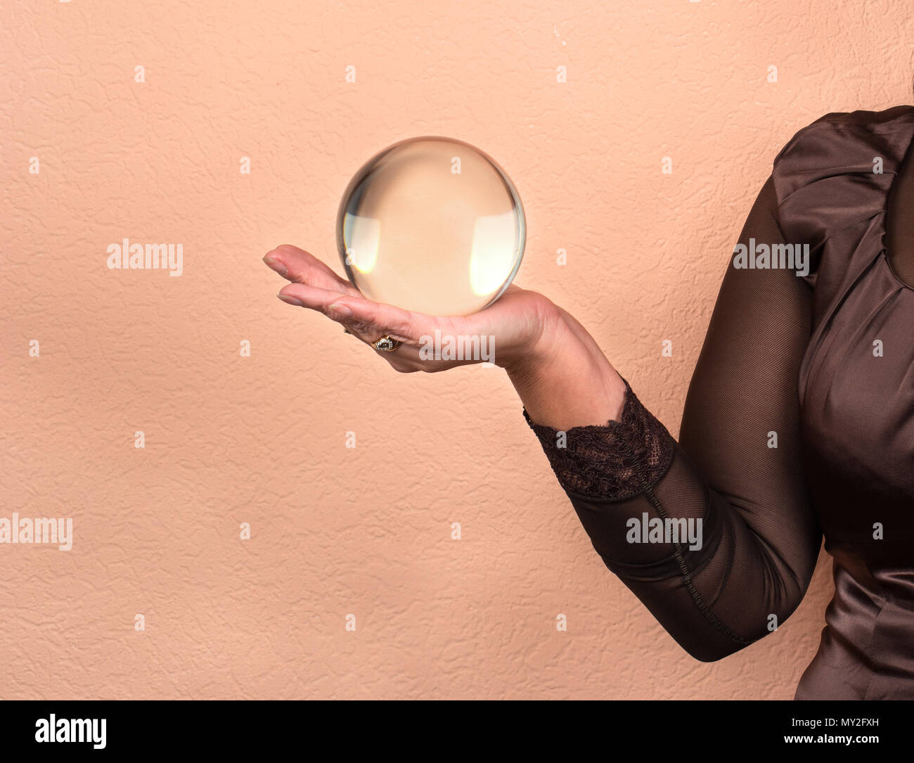 Female fortune teller holding a magic ball Stock Photo