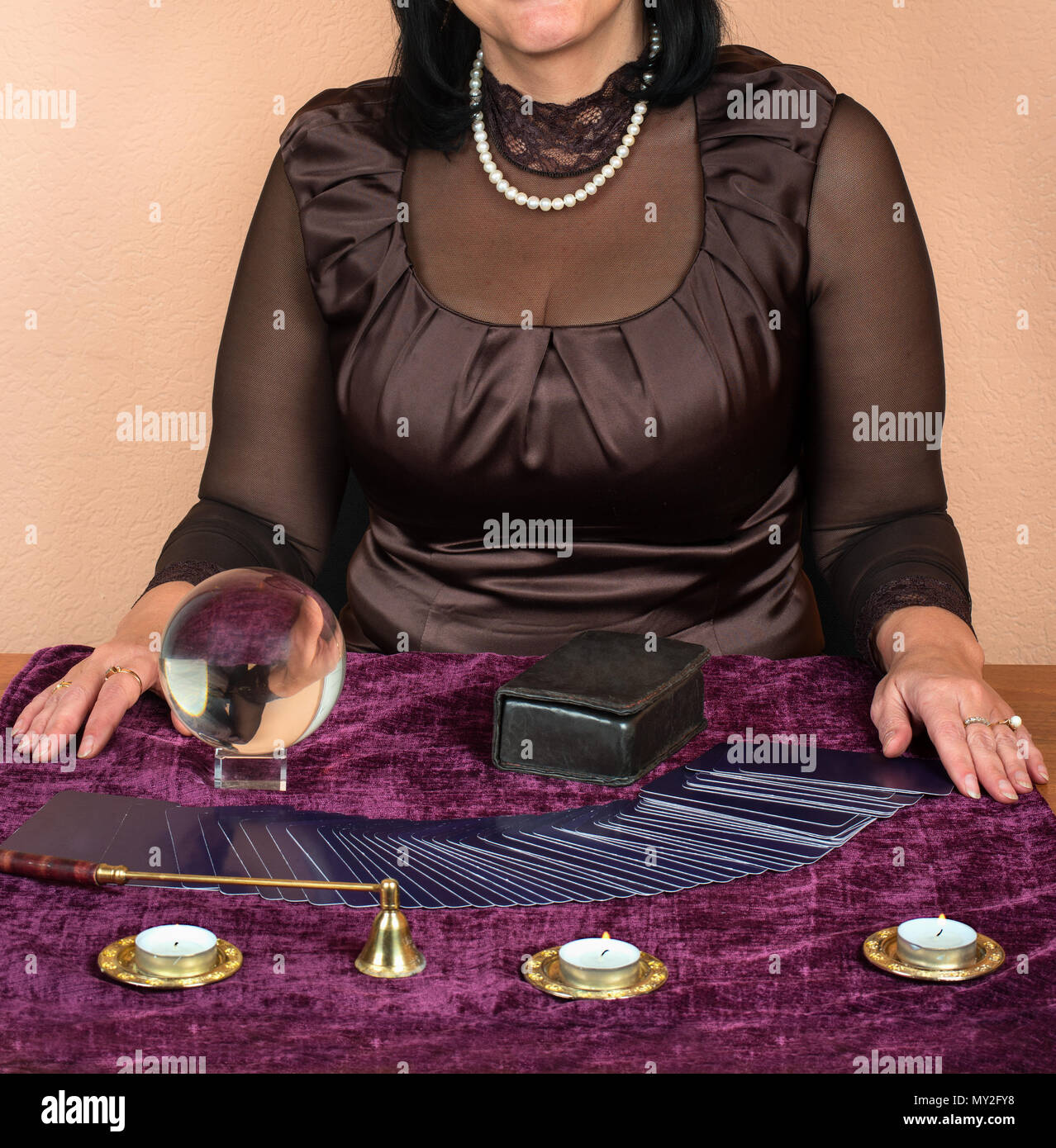 Woman guessing on the Tarot cards at the table - Stock Image