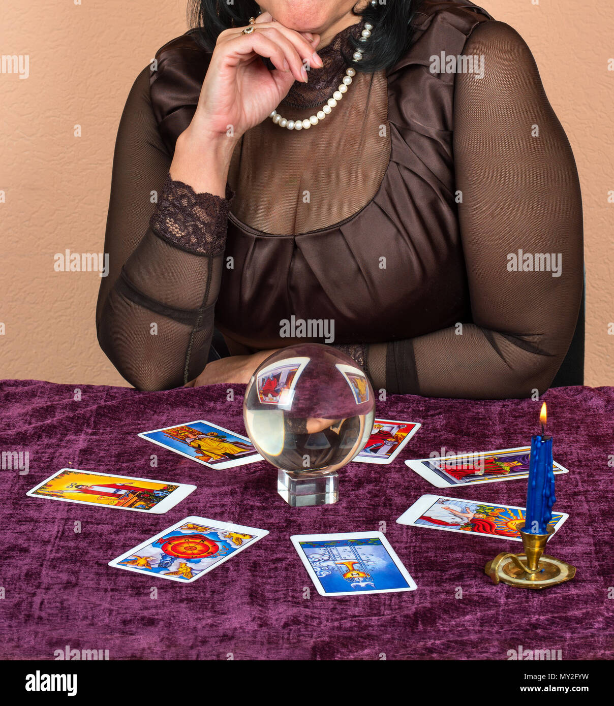 Woman laid on the table the Tarot cards for fortune telling - Stock Image