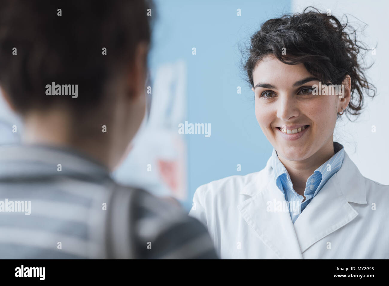 Doctor meeting a patient at the clinic for a medical consultation, healthcare and medicine concept - Stock Image