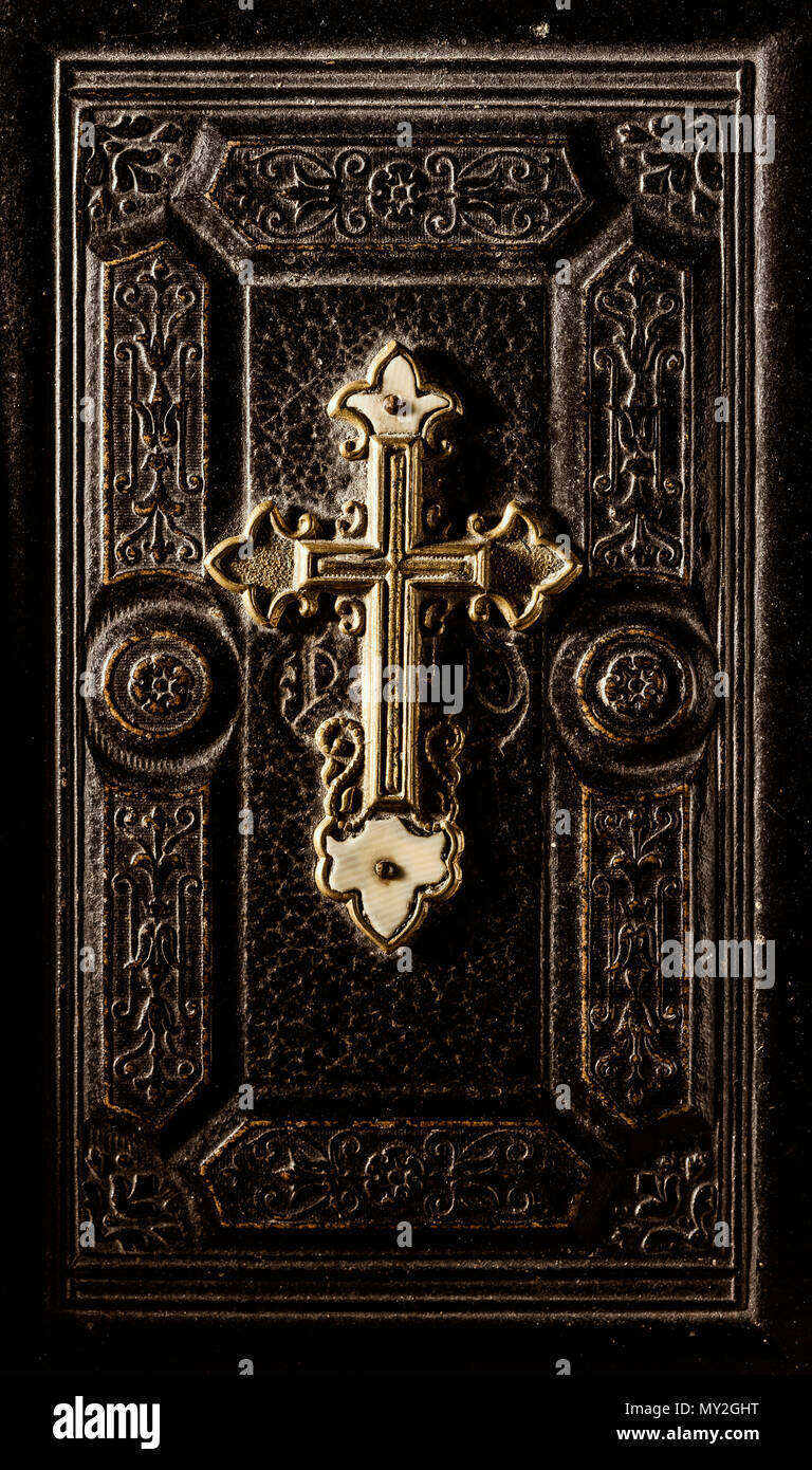 Precious antique Bible cover with golden cross and decoration, religion and spirituality concept - Stock Image