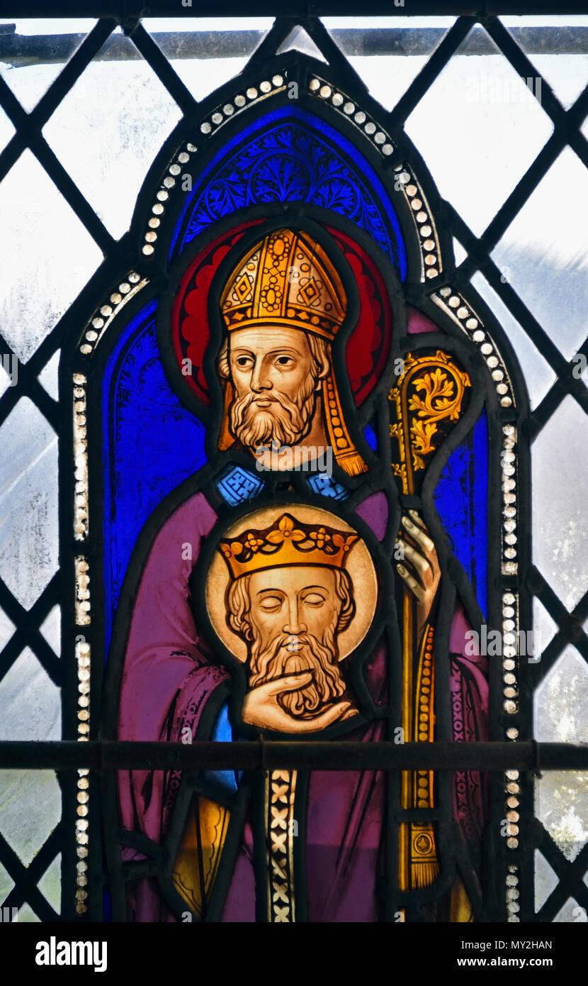 Saint Cuthbert with the head of Saint Oswald. Stained glass window, Parish Church of Saint Kentigern, Great Crosthwaite, Cumbria. - Stock Image