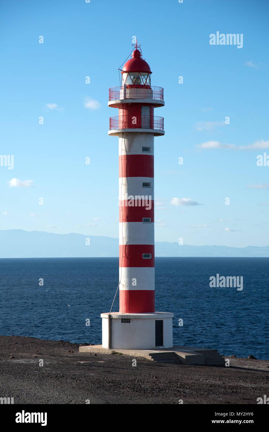 Punta Sardina Lighthouse overlooks the Atlantic ocean Stock Photo