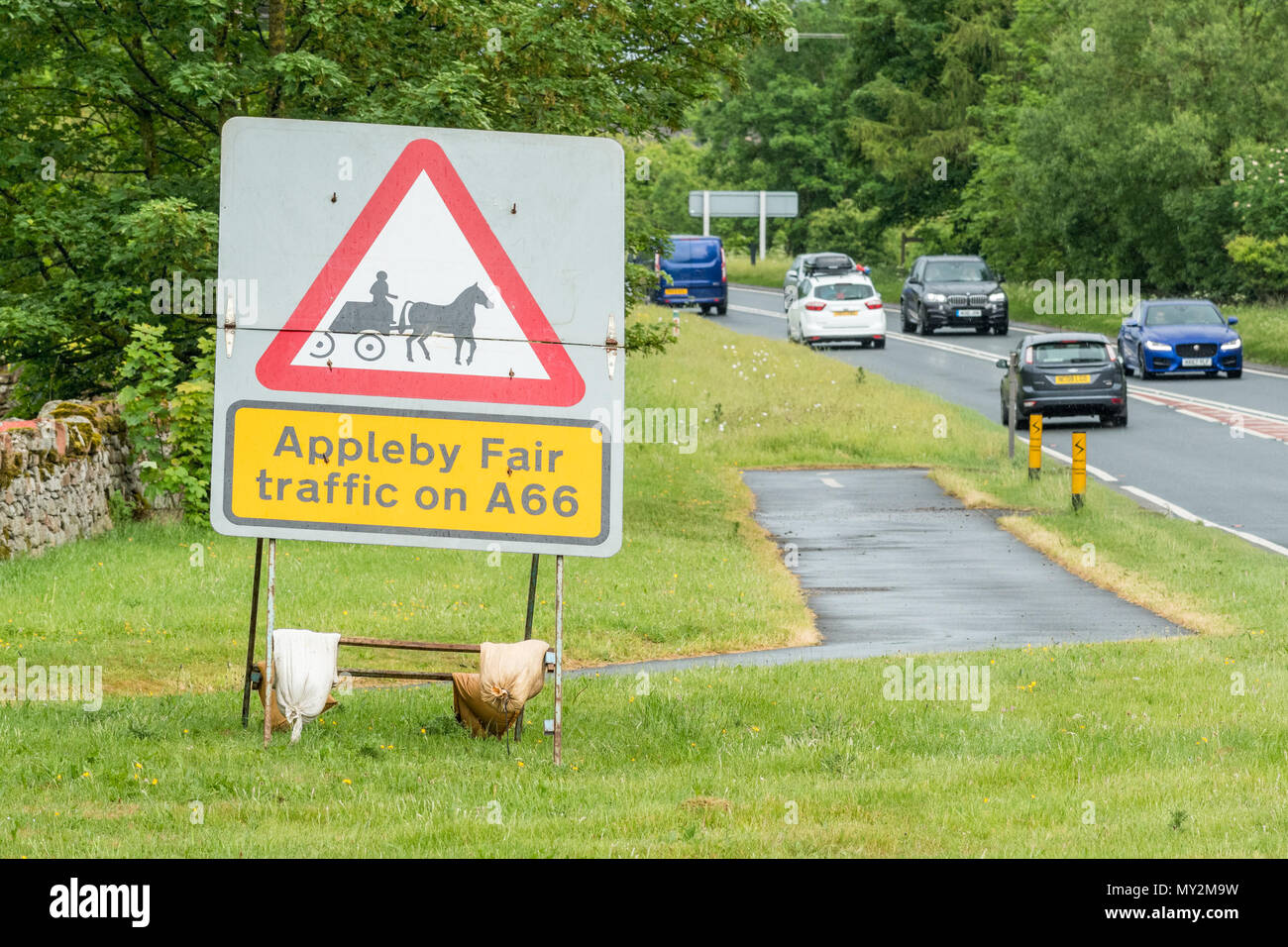 Appleby Fair traffic on A66 road traffic sign - Stock Image