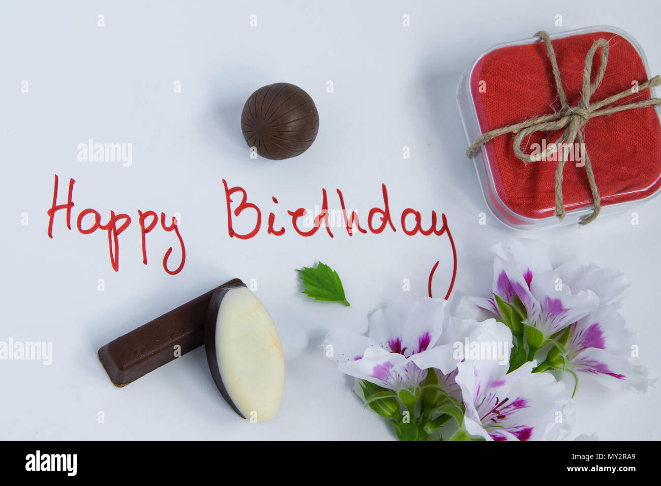 Happy Birthday Greeting Card With Gift Box Fresh Flowers And Chocolates On White Background