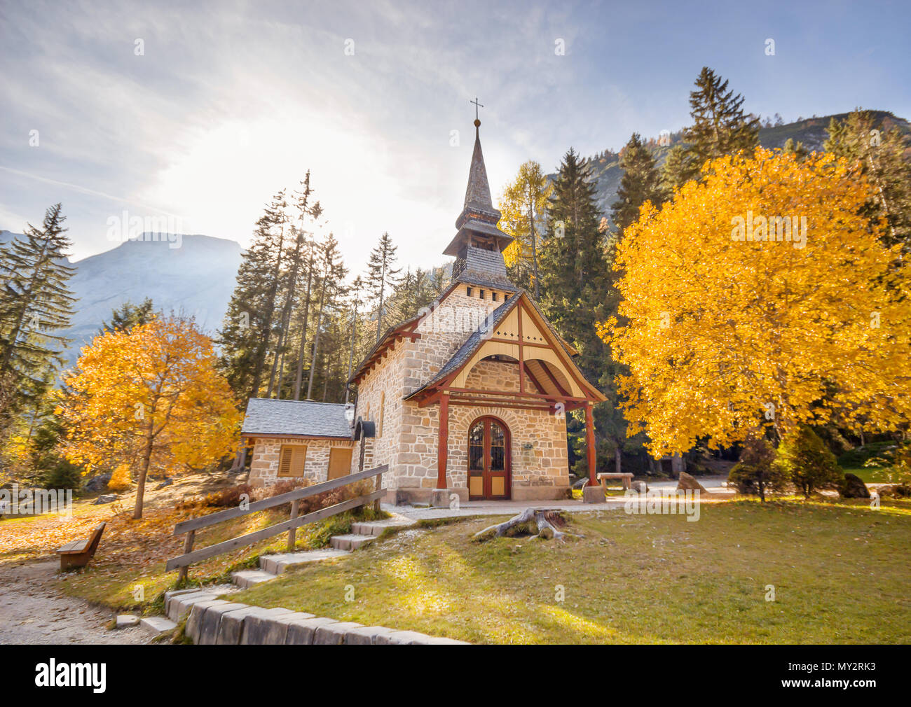 small church in countryside in the fall background stock photo