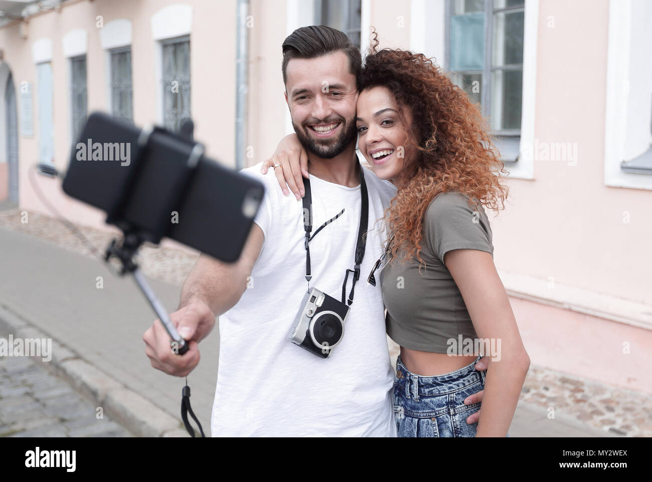 Happy traveling couple making selfie, romantic mood. - Stock Image