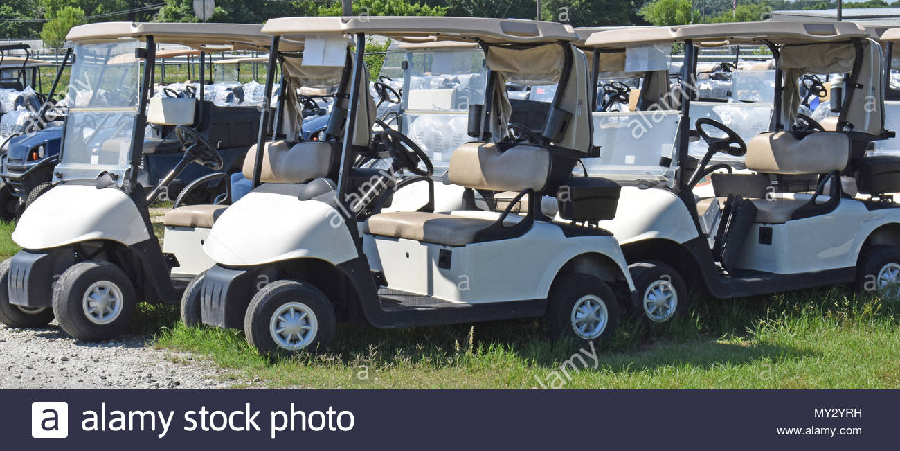 Used Golf Carts Await Sale or rental Stock Photo: 188765125 - Alamy