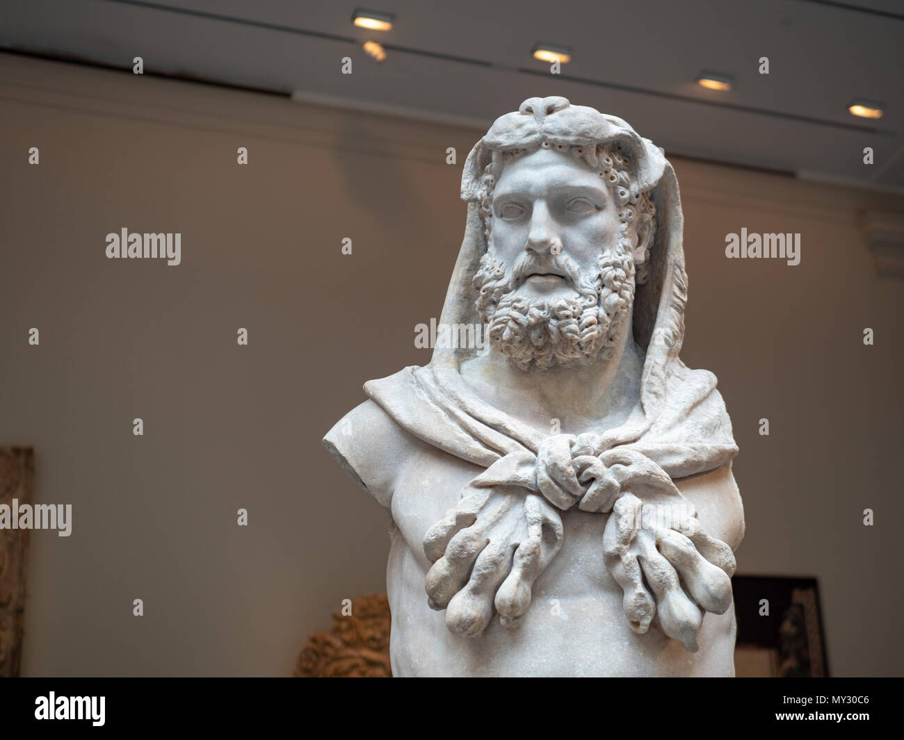 A marble statue of a bearded Hercules weating lion skin, made around 1st century A.D. in the Roman times. Stock Photo