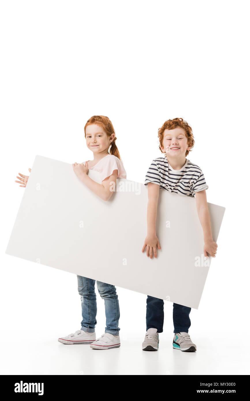 d6dbfffcf3d3 adorable little kids holding blank placard and smiling at camera isolated  on white - Stock Image