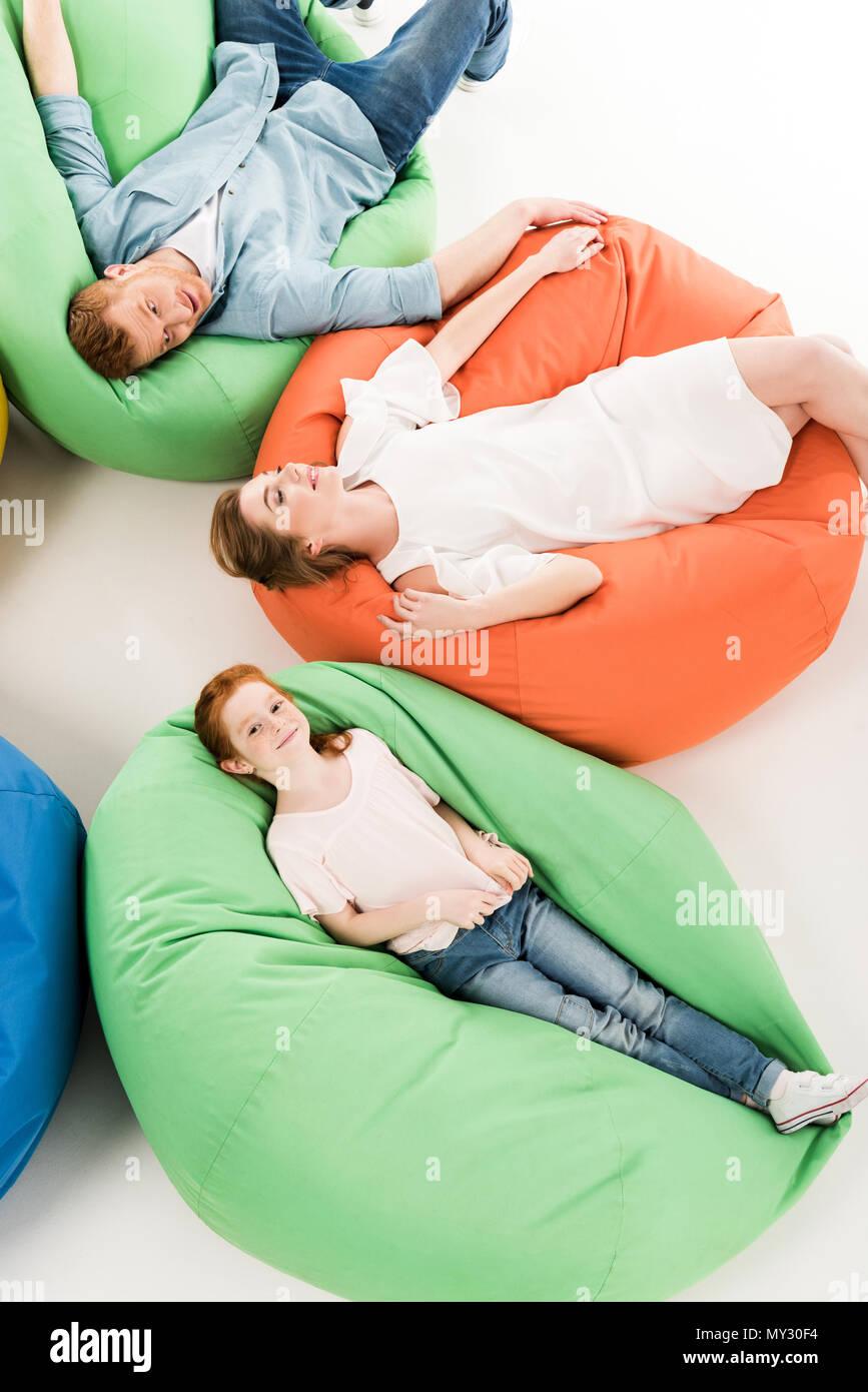 Stupendous Top View Of Happy Parents With Cute Little Daughter Resting Machost Co Dining Chair Design Ideas Machostcouk
