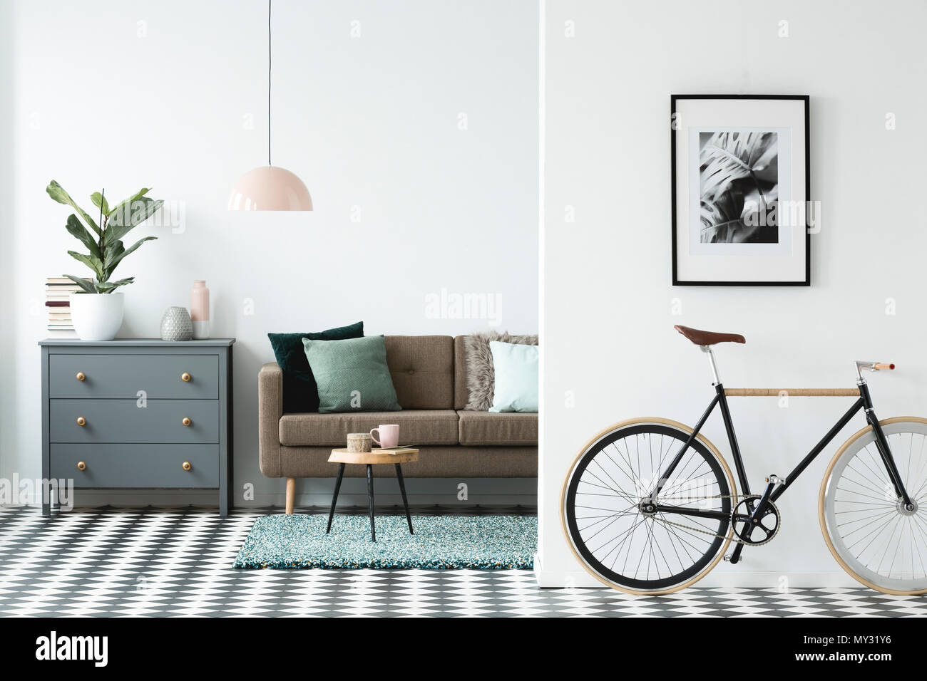Bike and poster on the wall in a modern living room interior with a ...