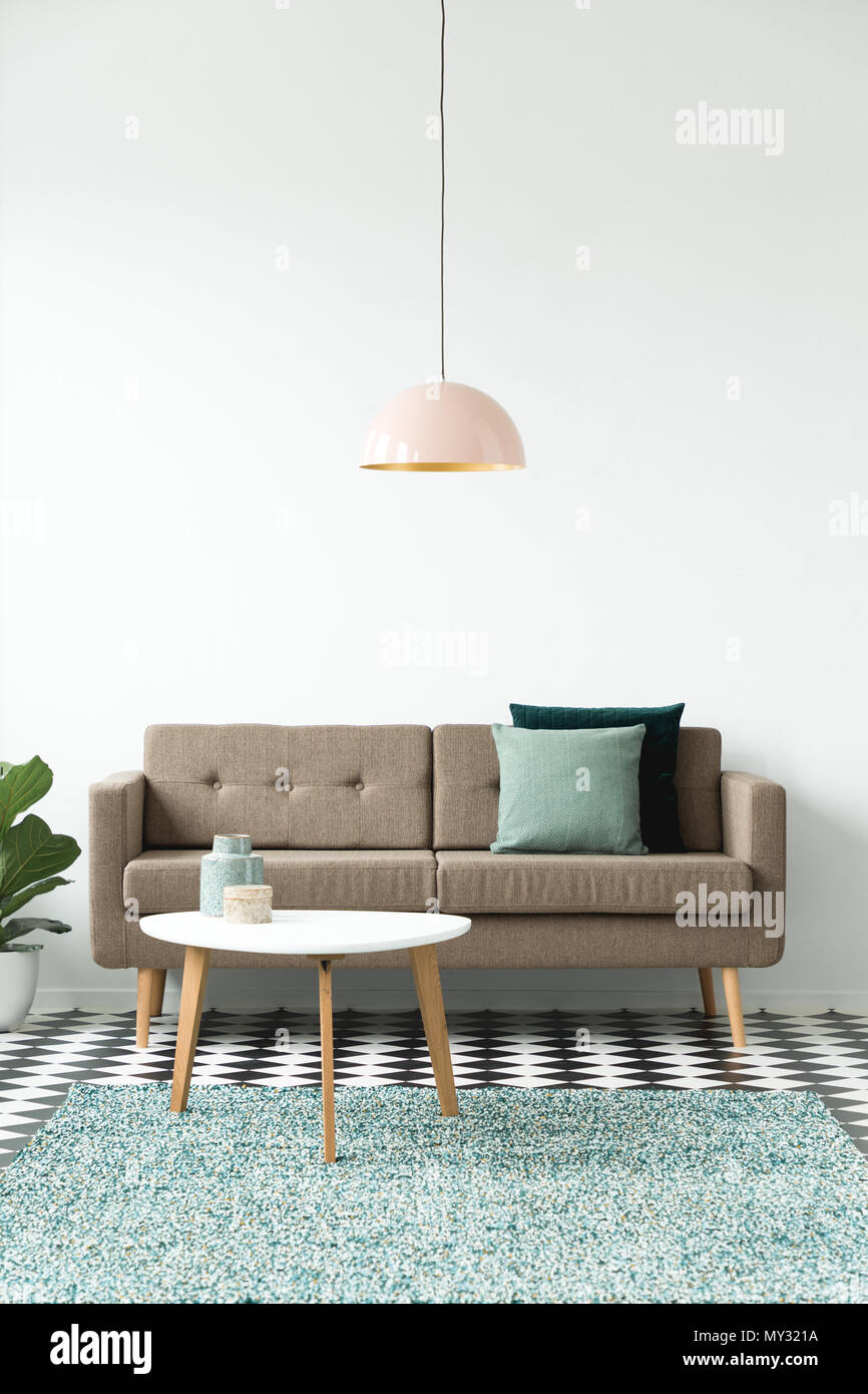 Front View Of A Sofa With Pillows Coffee Table Chandelier And