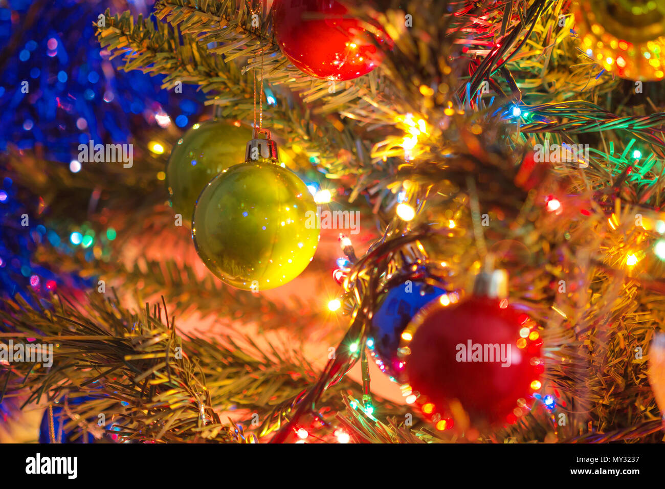 Decorated Christmas tree on blurred,  Beautiful Christmas ball hanging decorated christmas tree background. Stock Photo