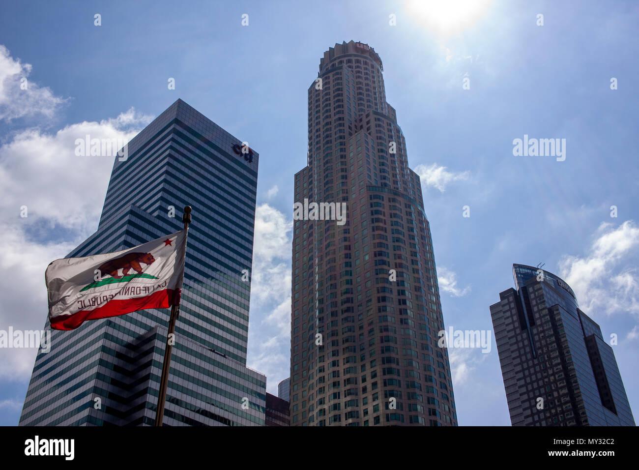 Californian Flag waves beneath Downtown LA skyscrapers. - Stock Image