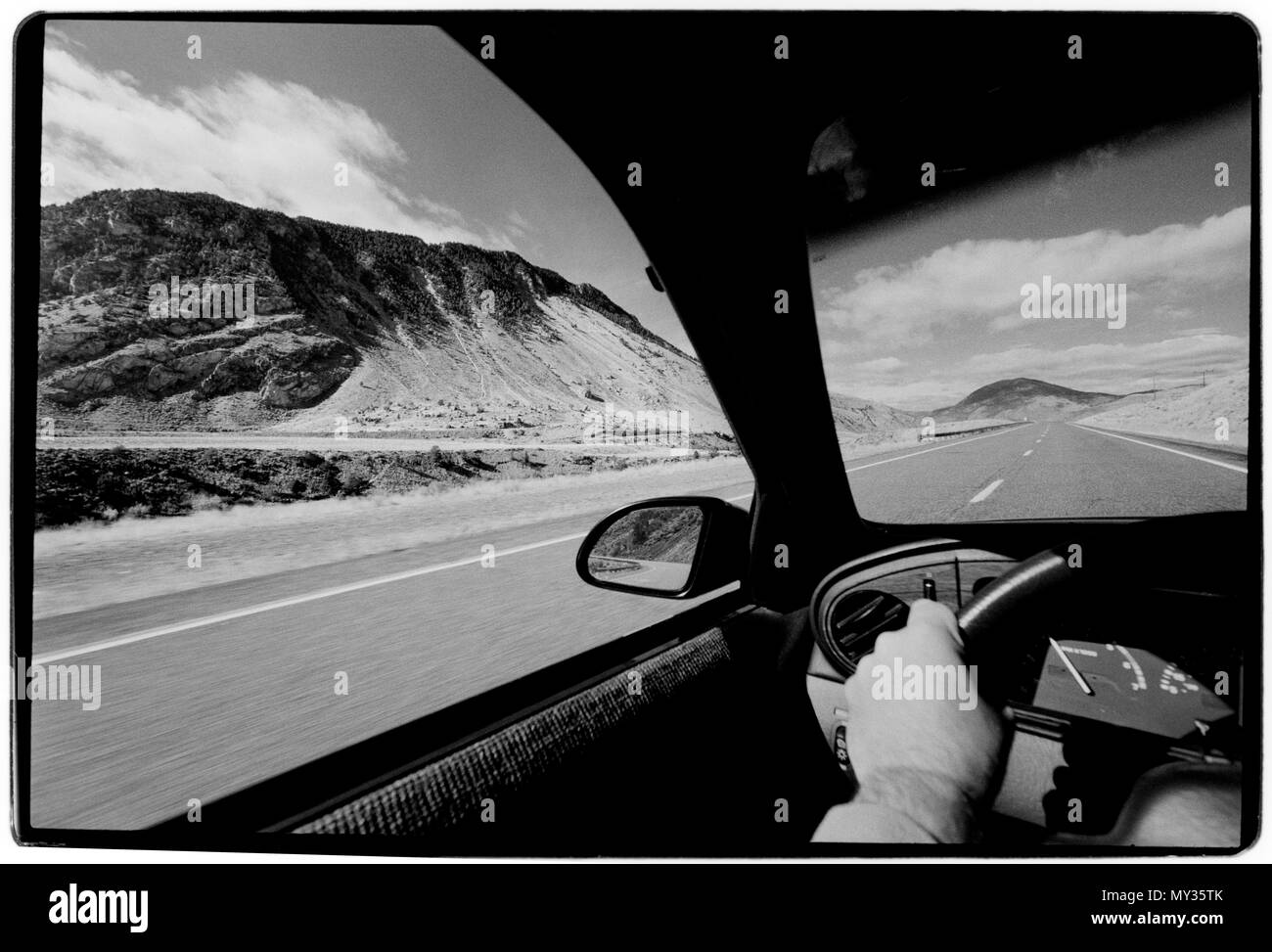 Montana USA, on the road. 1988 View from a car speeding along the road-highway in Montana, North Entrance Road, the USA - Stock Image