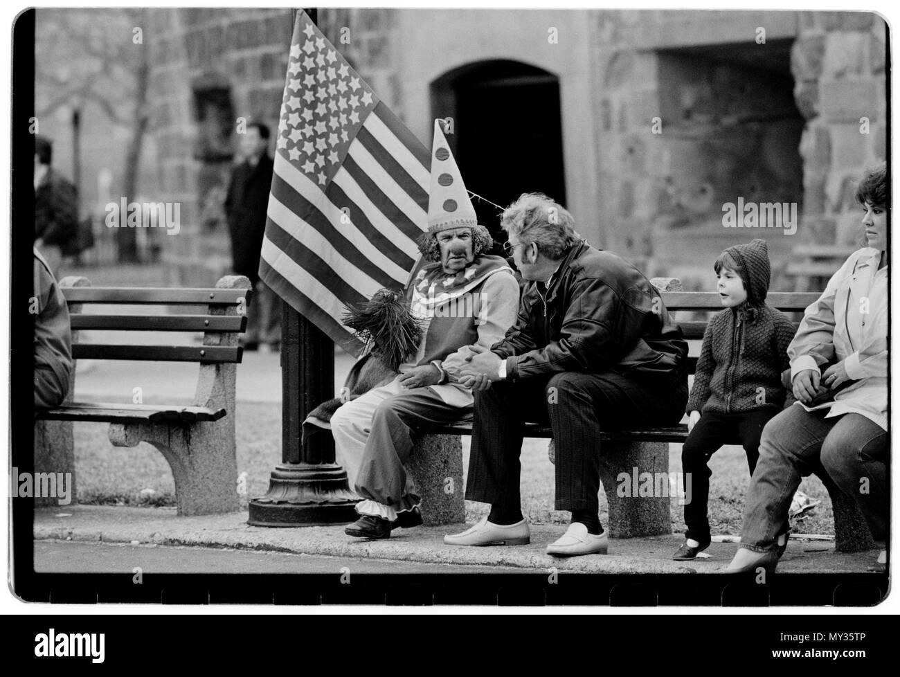 New York City USA 1988 Clown man at Battery Park, Manhattan on a cold Sunday morning. - Stock Image
