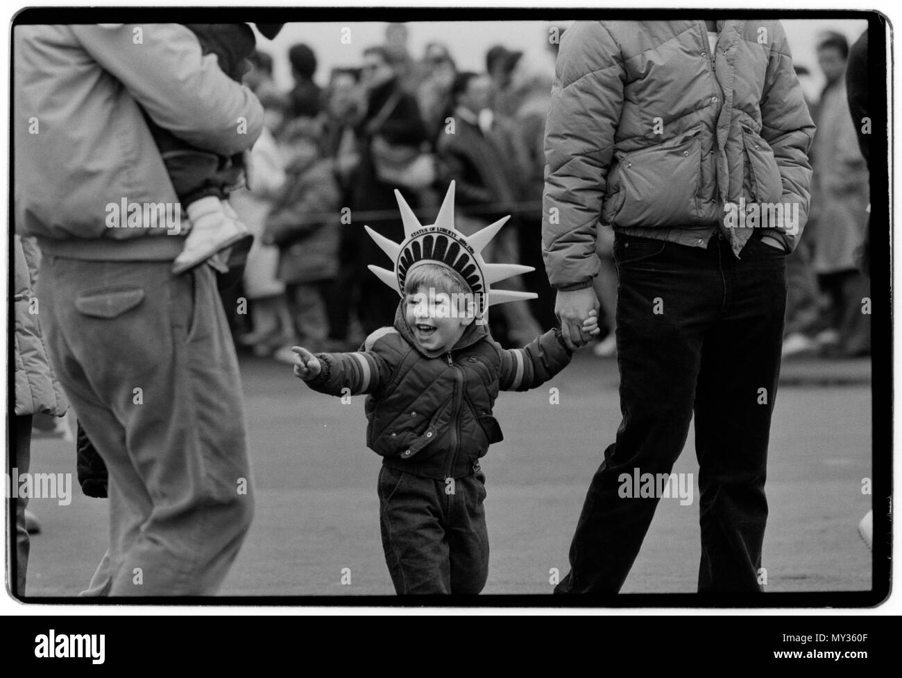 New York City USA 1988 Child wears Statue of Liberty hat in Battery Park, Manhattan, on a cold Sunday morning. - Stock Image