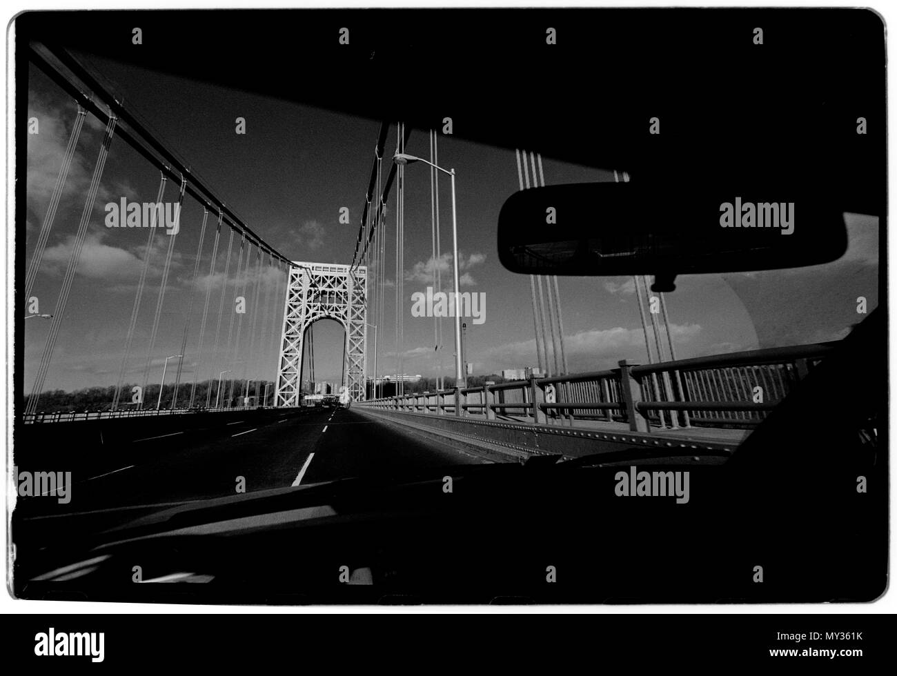 New York City USA 1988 George Washington Bridge The George Washington Bridge – known informally as the GW Bridge – is a double-decked suspension bridge spanning the Hudson River between the Washington Heights neighborhood of Manhattan in New York City and Fort Lee, New Jersey. As of 2016, the George Washington Bridge carried over 103 million vehicles per year,[8] making it the world's busiest motor vehicle bridge. It is owned by the Port Authority of New York and New Jersey, a bi-state government agency that operates infrastructure in the Port of New York area.  A bridge across the Hudson Rive - Stock Image