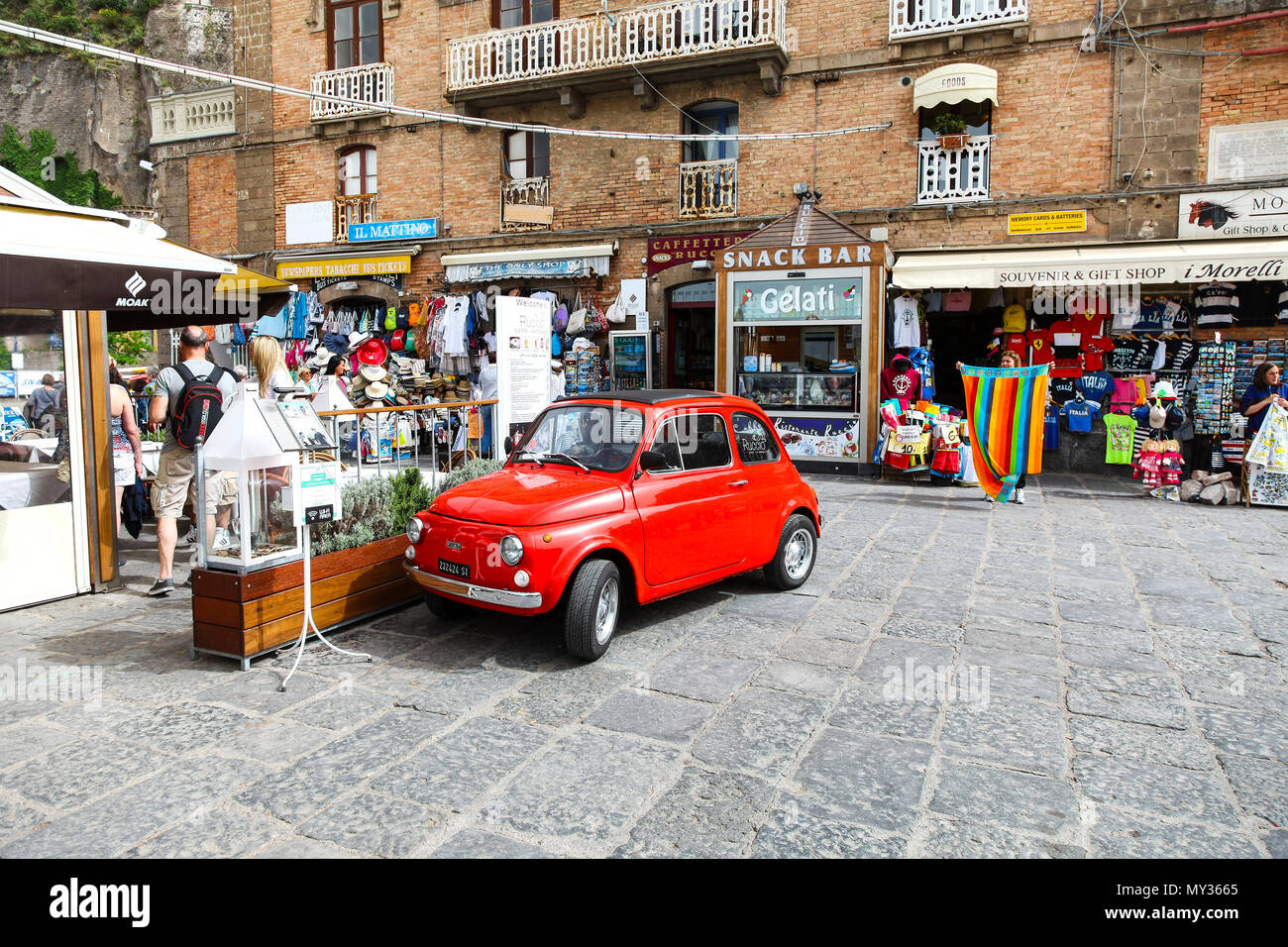 An old red Fiat 500 car advertising the Ruccio Restaurant and Café, Sorrento, Italy - Stock Image