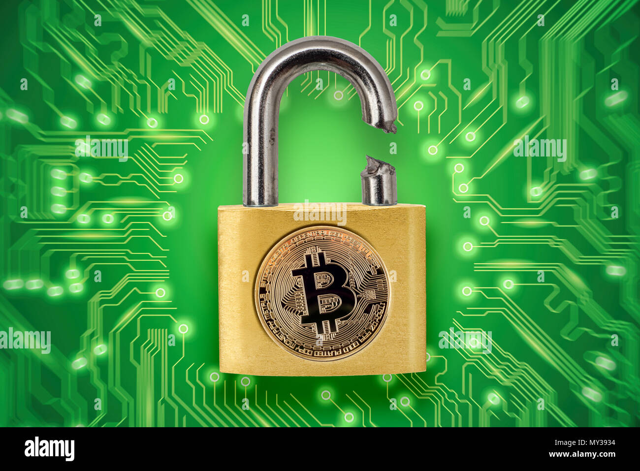 Broken padlock with bitcoin logo. Conceptual picture illustrating crypto currency hacking and theft. - Stock Image