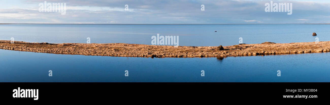 South Iceland. A panoramic view of the peaceful tidal lagoon of Holtsós, just south of  Eyjafjallajökull, seen in the early morning from the Ring Road - Stock Image