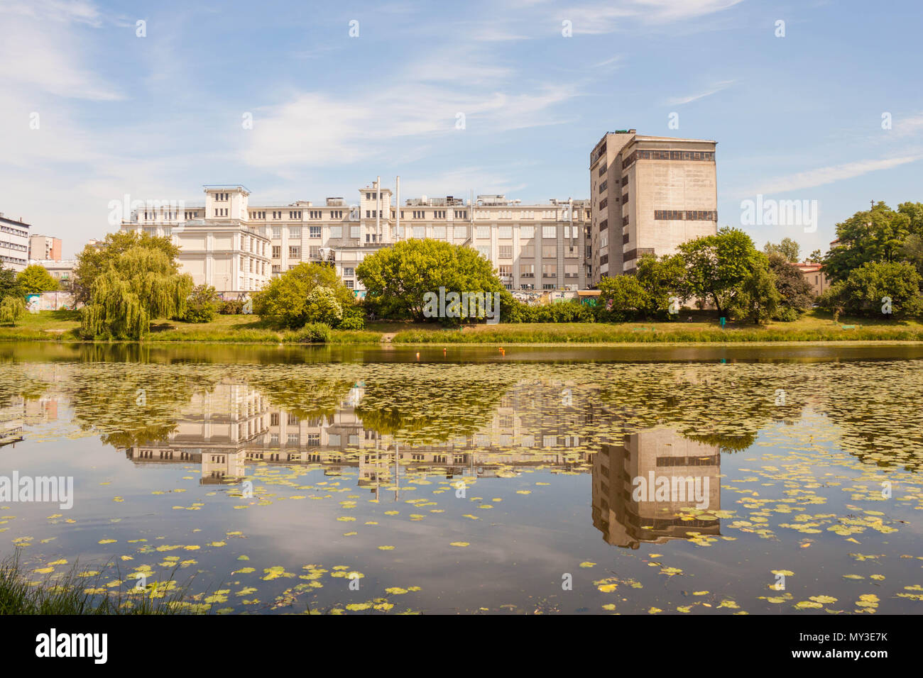 Warsaw, Poland - June 10, 2017: E.Wedel chocolate factory on Kamionkowskie lake in Praga district. The factory was opened in 1934 by Jan Wedel. - Stock Image