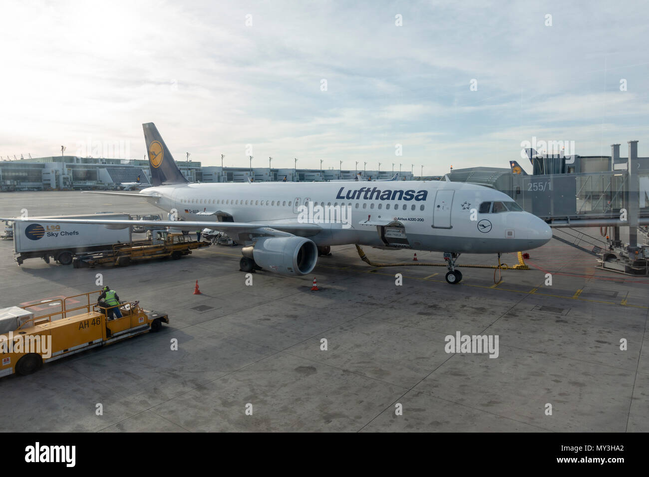A Lufthansa Airbus A320-200 on the stand in Munich Airport, (Flughafen München), Germany. - Stock Image